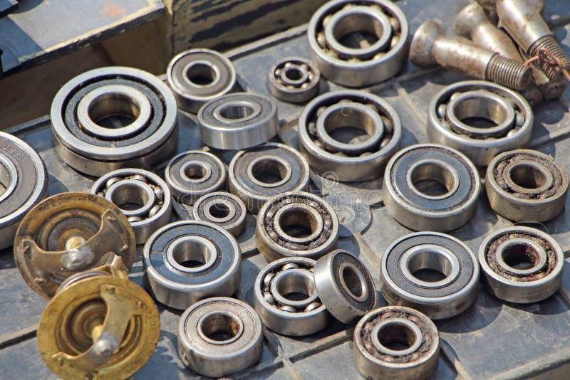 Old bearings. Rusty bearings, grey color, old screws, pile of old screws, tools elements, steel details, repair details, old rusty, texture, industry, workshop stock photos