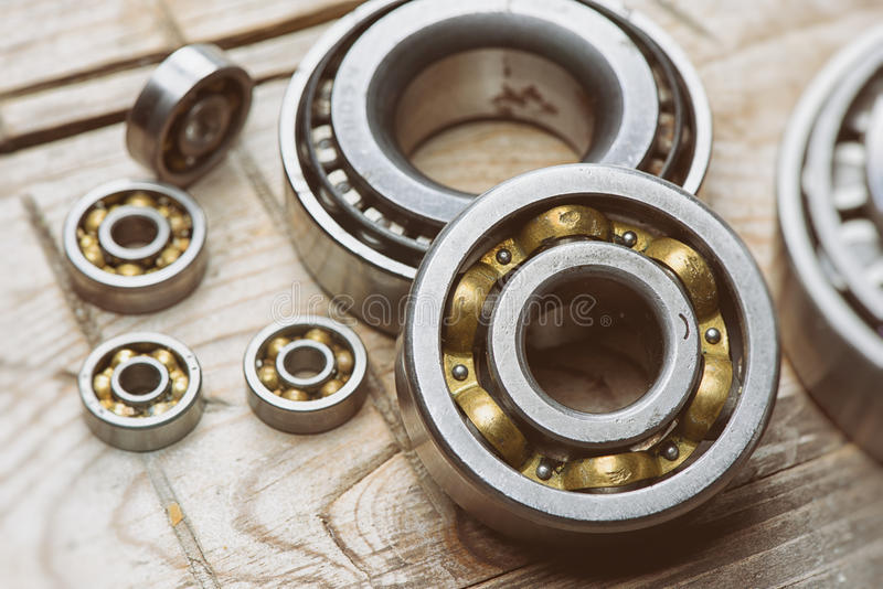 Old bearings. On a wooden background close up stock images