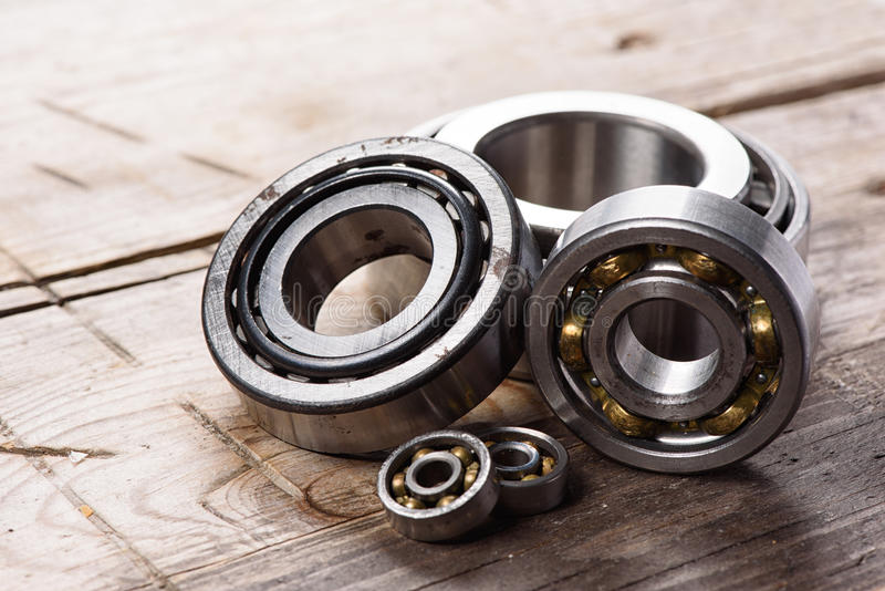 Old bearings. On a wooden background close up royalty free stock photo