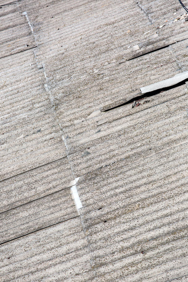 The old beaten roofing felt asbestos. Old beaten roofing felt asbestos, overlapping roof close up stock photography