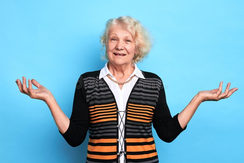 Old beautiful stylish blonde woman with clueless confused expression royalty free stock photography