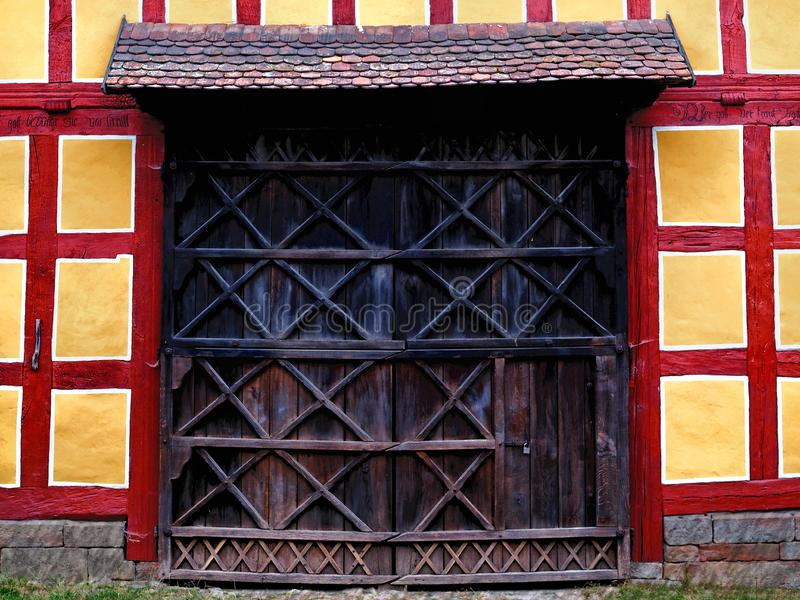 Wooden door of a truss house stock images
