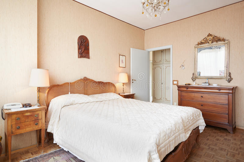 Old bedroom with double bed in ancient interior. Old bedroom with queen size bed in ancient italian house stock images