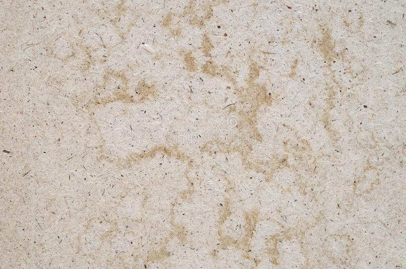 Old beige cardboard close up. Old beige cardboard closeup in sunny day royalty free stock image