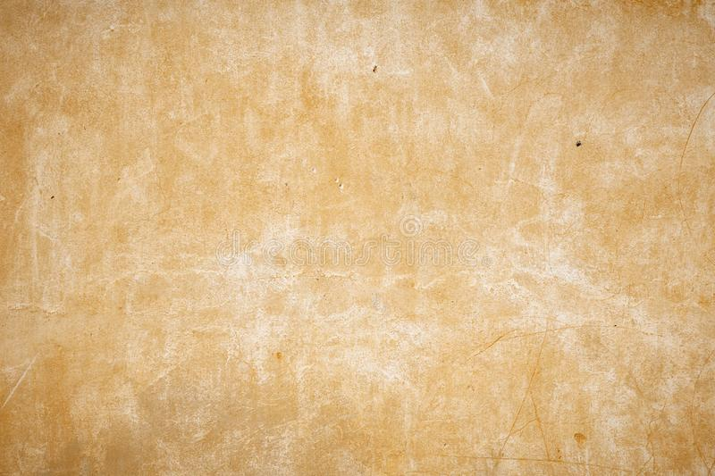 old beige wall with small holes in the wall stock photography