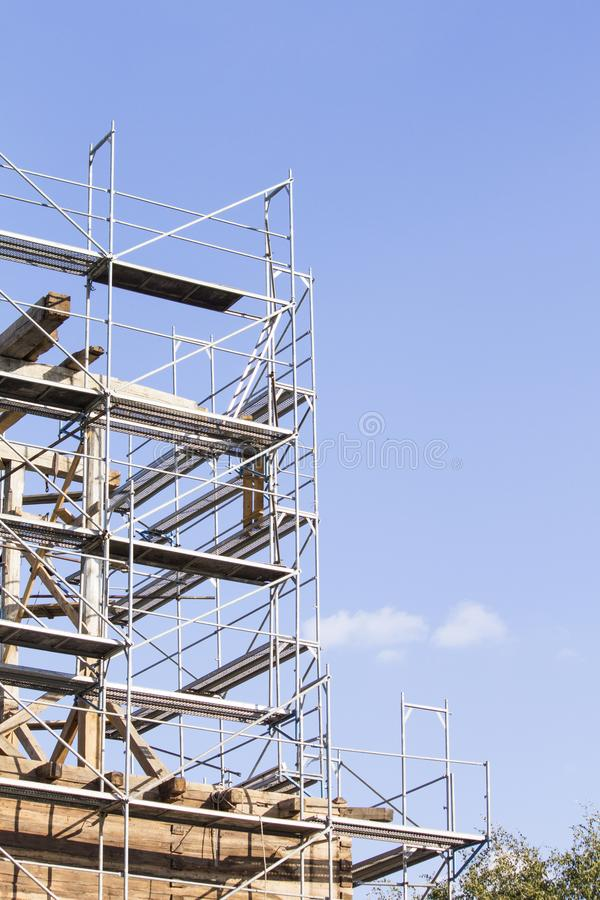 The old bell tower. Restoration of the old bell tower. Scaffolding royalty free stock images