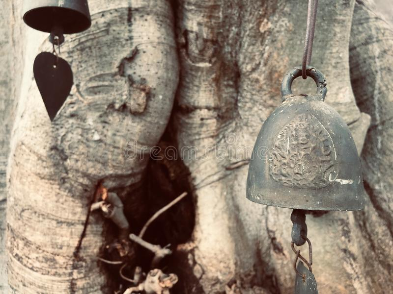 Old bell. And tree royalty free stock photo