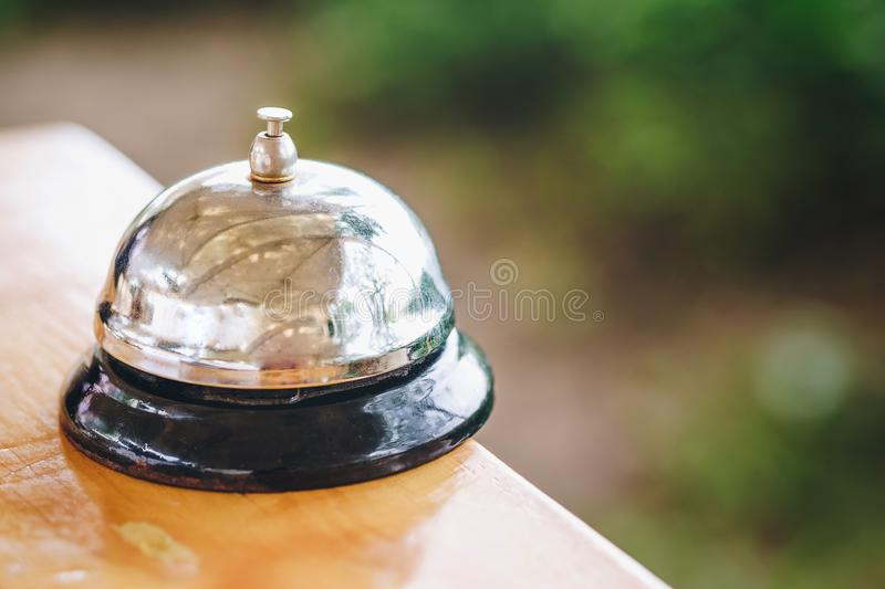 Old bell Used to be served at a restaurant on a wooden desk. stock photography
