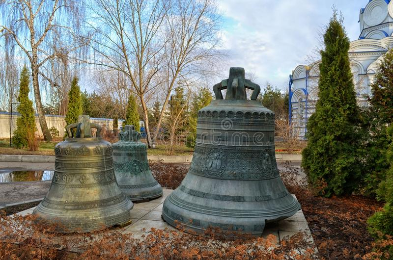 Old bells as a monument in the monastery in Kazan. Old bells as a monument to the persecution of religion in the Holy Dormition Zilant monastery in Kazan in the royalty free stock images