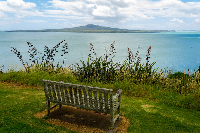 An Old Bench at Look Out Spot on North Head Auckland New Zealand. View to Rangitoto Island stock photography