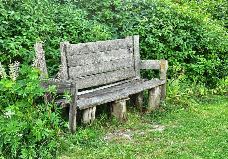 Old bench on a rural street. Quiet corner to relax royalty free stock images