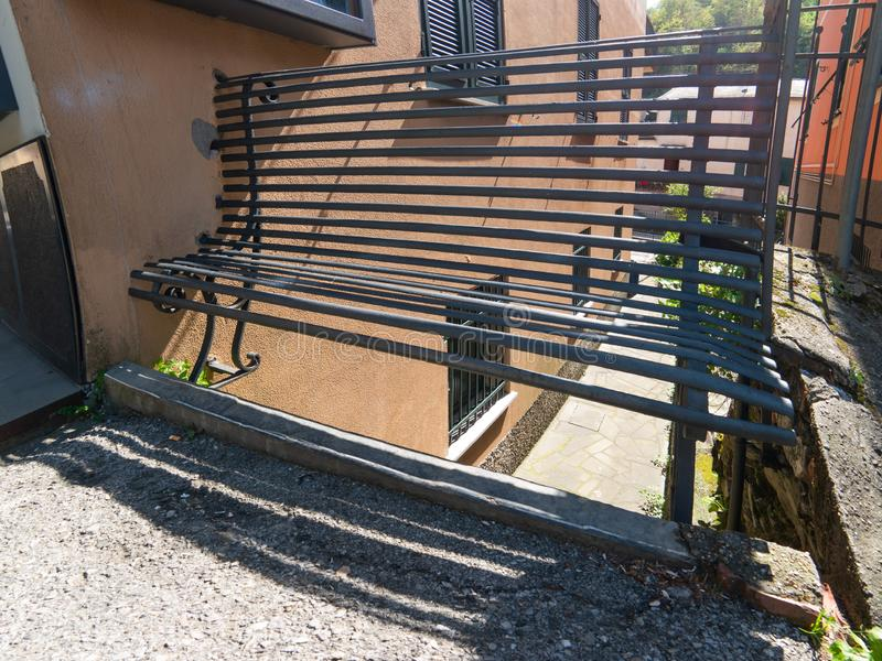 Old bench on the street. Old iron bench on the street stock image