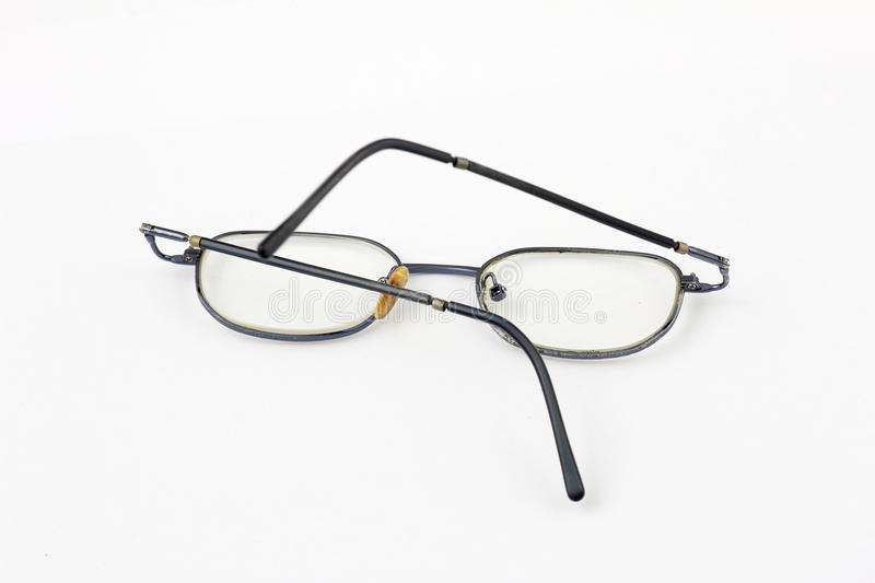 Old bent glasses royalty free stock images