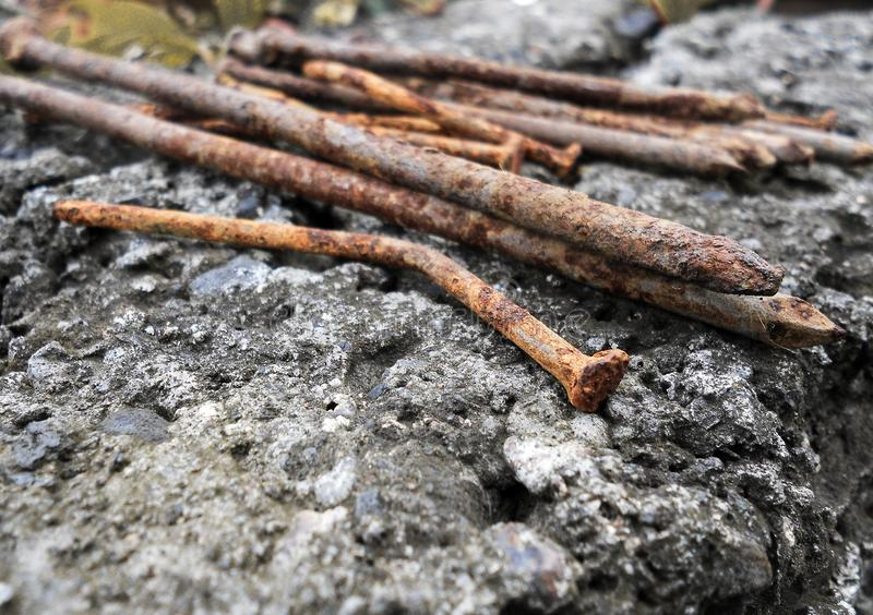 Rusty nails on the stone stock images