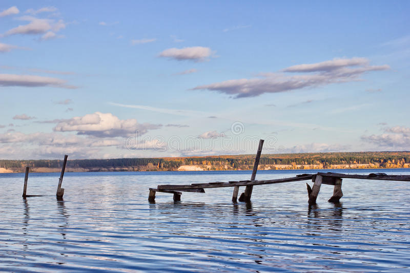 Old berth. Autumn. River. Old wooden berth stock photo