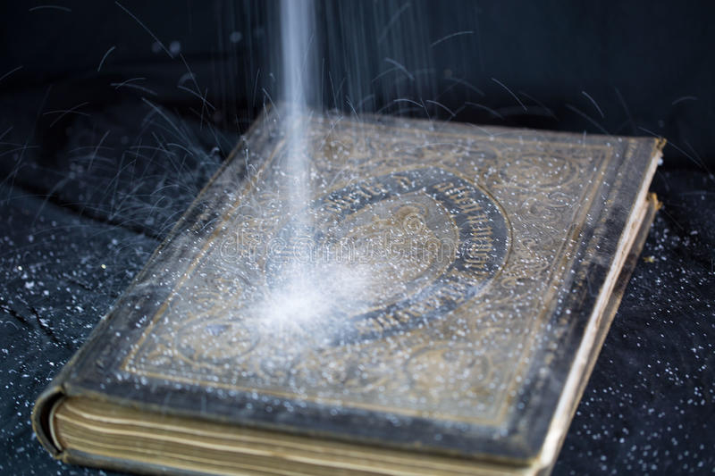 Old Bible, dust trickling from above. Sign , jesus royalty free stock image