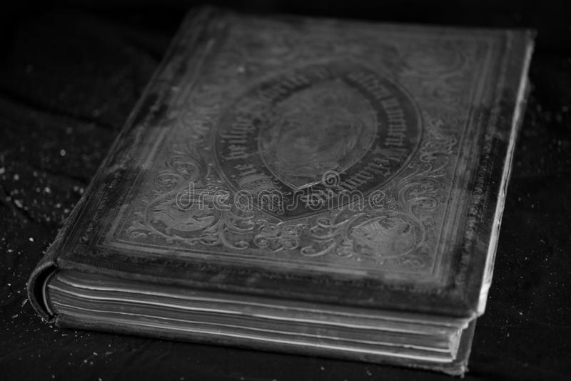 Old Bible, dust trickling from above. Sign , jesus royalty free stock images