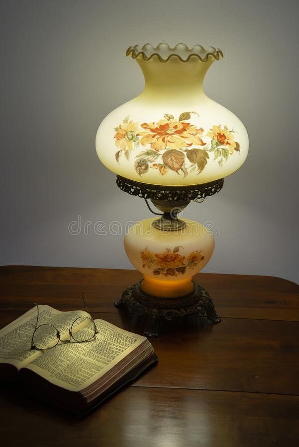Old bible and lamp stock photo