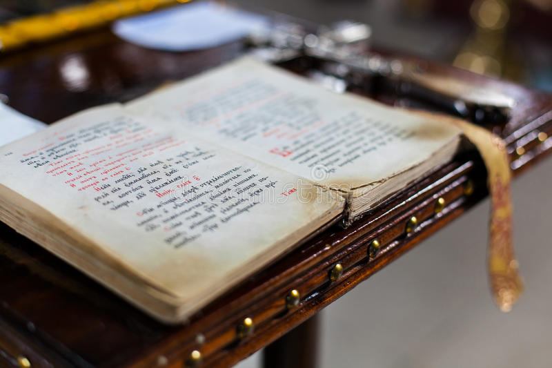 Old Bible. Open old bible in the church on chair,akathists, prayer book, the book of saints stock photo