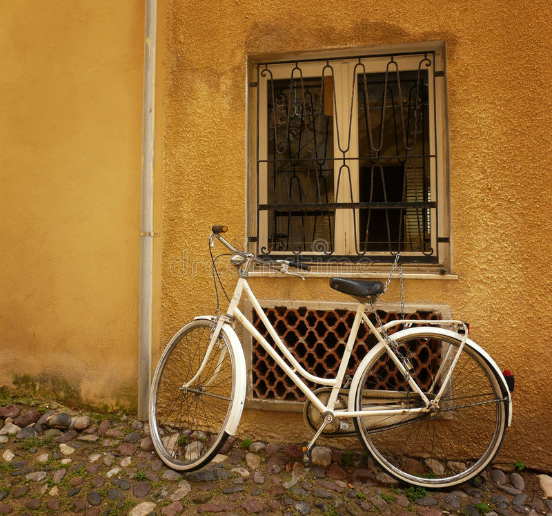 Old Bicycle Against Wall Stock Photography