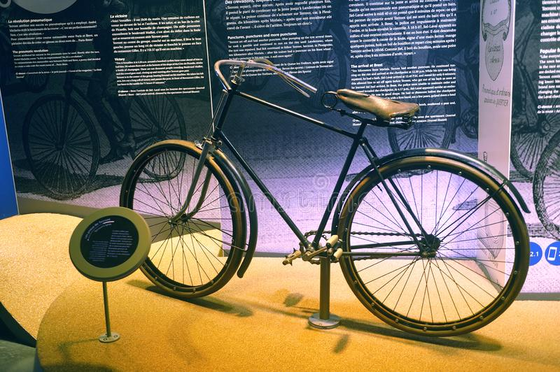 Old bicycle equipped for the first time at the time of tires exposed to the Michelin museum. In Clermont-Ferrand stock photography