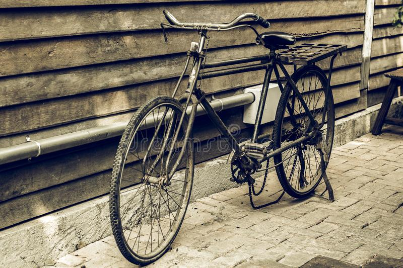 Old bicycle in invoice wood wall artwork royalty free stock photography