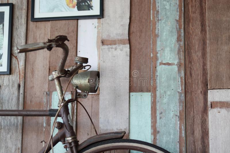 Old bicycle lean on aged wooden wall. royalty free stock image