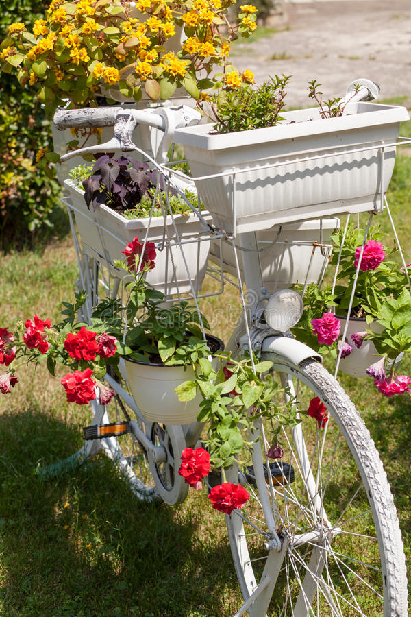 Old Bicycle With Potted Flowers Stock Photo
