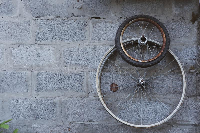 Old bicycle tires in the garage stock photo