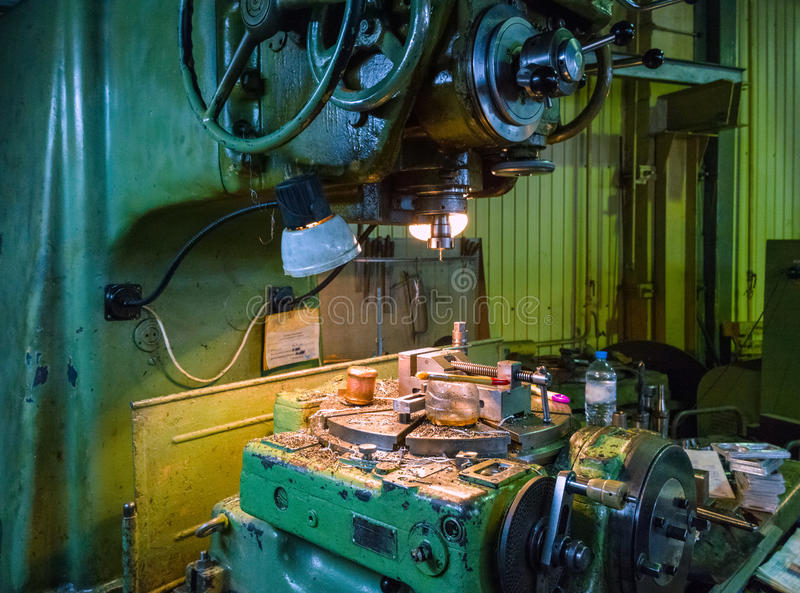 Old big 5-axis milling machine manual control indexing table stock image