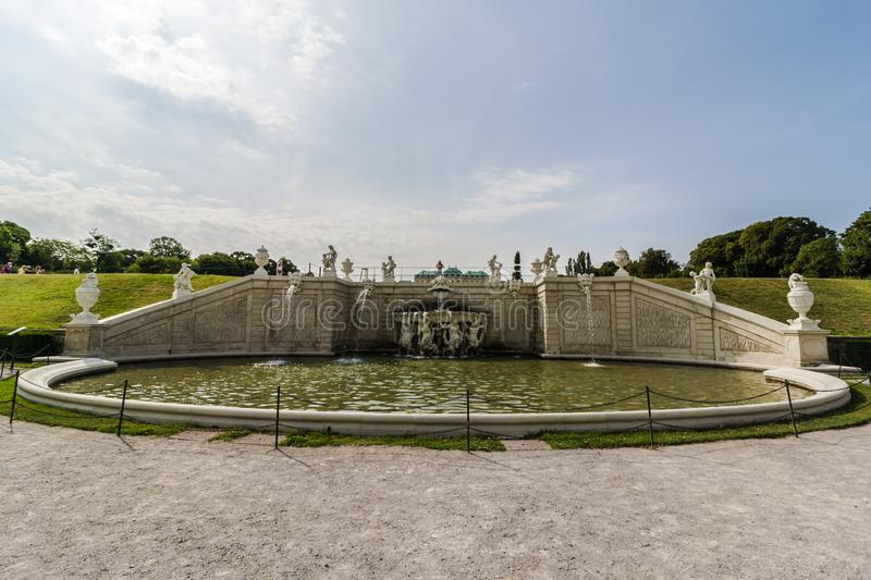 Old big baroque fountain made of white marble. Beautiful fountain with antique sculptures in the park stock images
