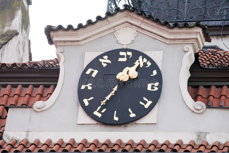 Old big watch in Jewish quarter of Prague. Old big outdoor watch in Jewish quarter of Prague closeup view royalty free stock images