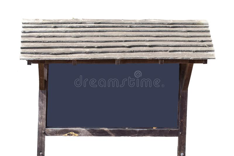 A old big wooden billboard or brown stand with a blank dark blue information board for tourist attraction, special destination or royalty free stock photography