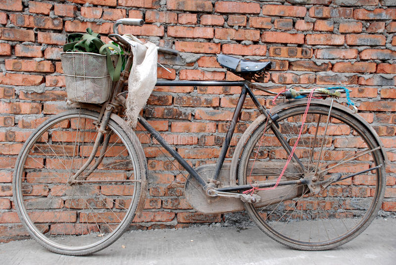 Old bike. An old bike beside the wall royalty free stock photography