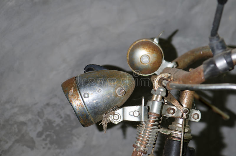 The old bike was parked cement wall left home. Rusty old lamp. And bell on the handlebars royalty free stock image