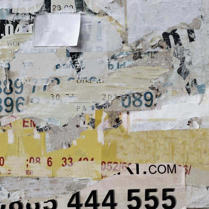 Old Billboard With Torn Paper Posters Texture Or Vertical Back royalty free stock photos