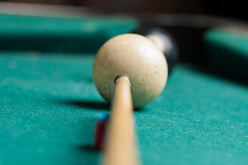 Old billiard ball 8 on a green table. billiard balls isolated on a green background stock photo