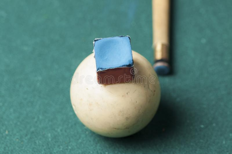 Old billiard white ball and stick on a green table. billiard balls isolated on a green background. Old billiard white ball and stick  on a green table. billiard stock image