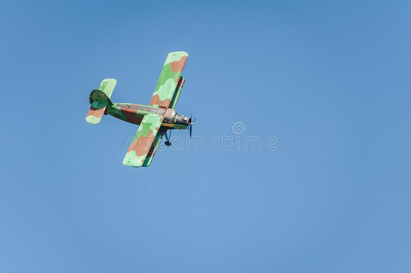 Old biplane aircraft flies and shows a performance at the airshow in the clear blue sky. Tukums, Latvia, July 20, 2019: Airshow `Wings over Baltics Airshow 2019 stock image