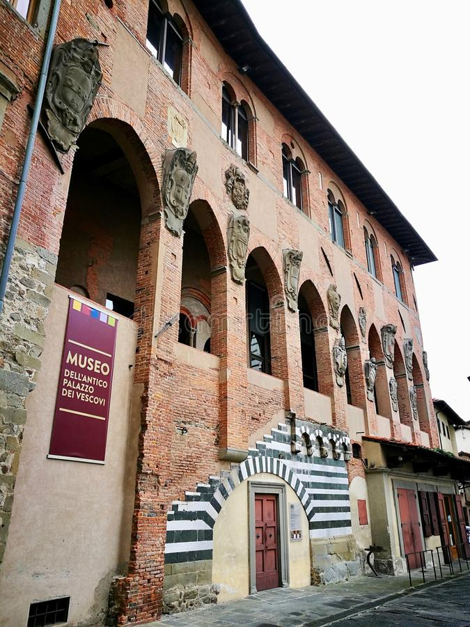 Old bishop palace in Pistoia Italy. Old bishop palace gothic Pistoia Tuscany Italy sharp on white sky background view from below stock photos