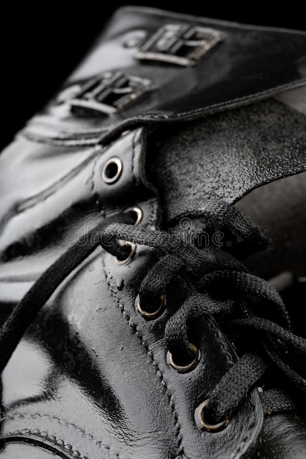 Old black army boots wet from the rain. Footwear resistant to difficult terrain conditions. Dark background art autumn casual classic closeup clothing dirty royalty free stock photos