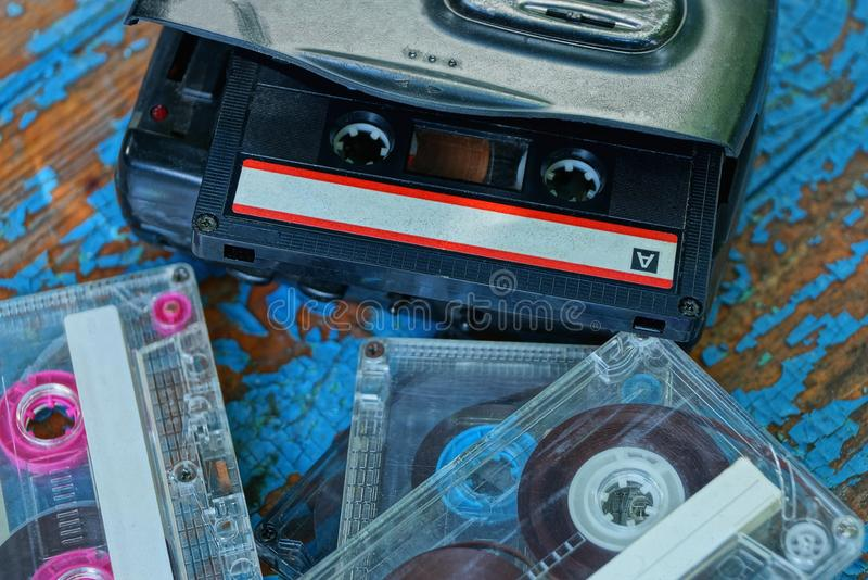 Black audio player with a cassette is lying on a worn blue table royalty free stock images