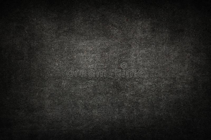 Old black background. Grunge texture. Dark wallpaper. Blackboard stock photography