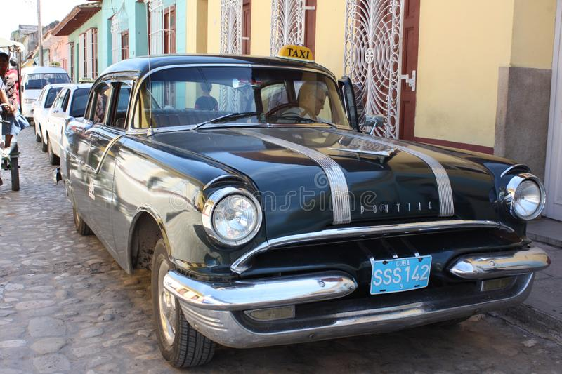Old black beautiful american car. Cuba. Very interesting - in Cuba, a lot of old American cars have been preserved, and many of them are in working mode. This stock photos