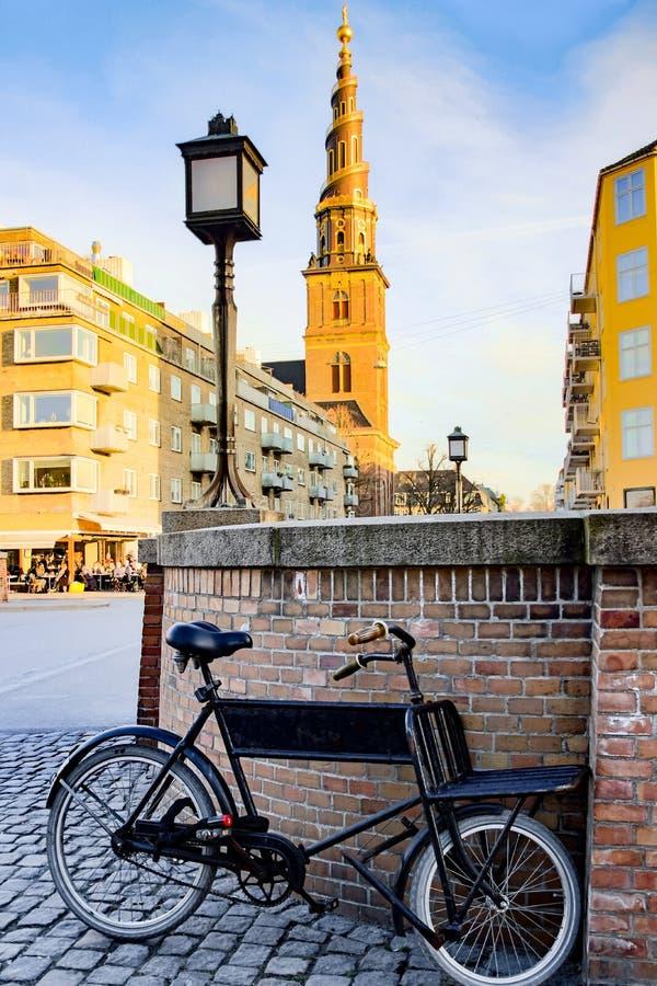Old black bicycle in front of Vor Frelsers Kirke stock image