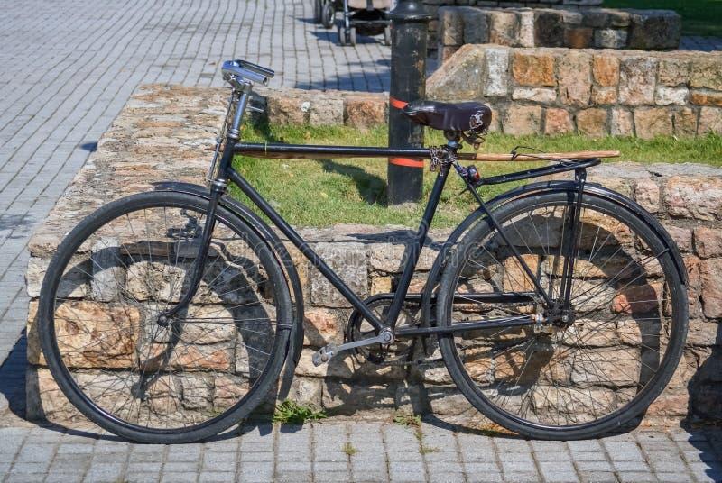 Old black bicycle stock photo