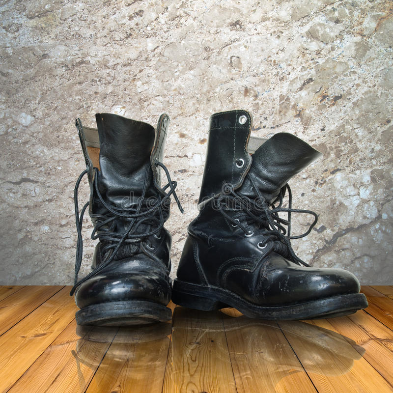 Old black boot on wood floor stock photo