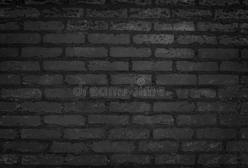 Old Black Brick Wall Texture and Close-Up Background royalty free stock images