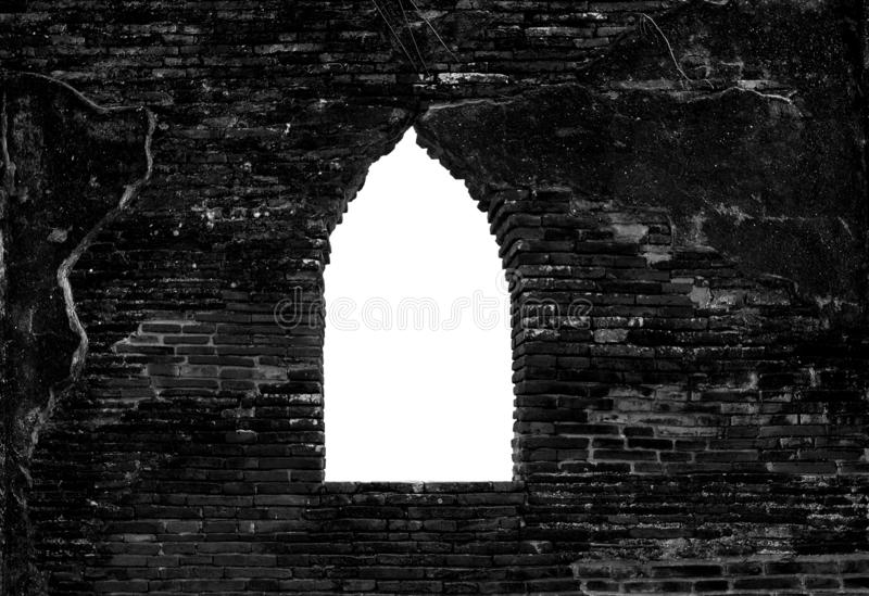 Old black brick wall texture and opening window. Clipping path include in this image.  stock photo