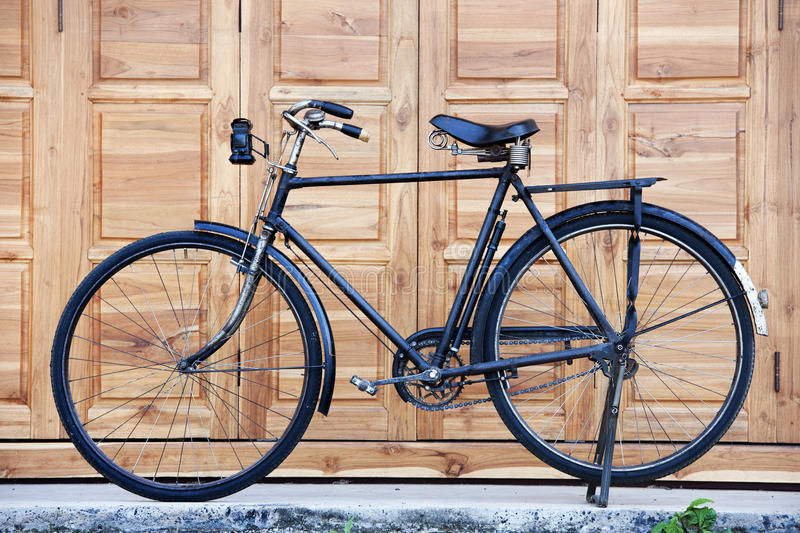 Old black classic bicycle royalty free stock image